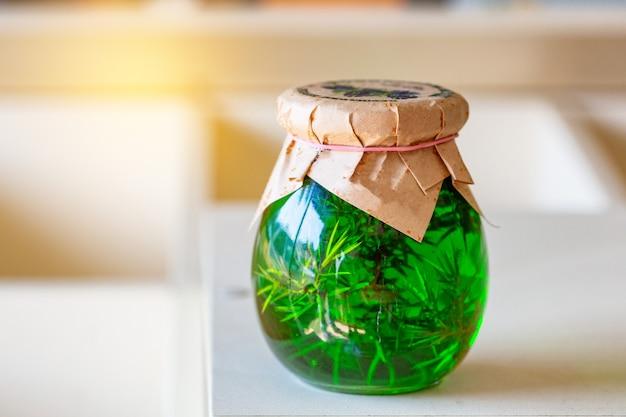 In a glass jar jam, juniper green