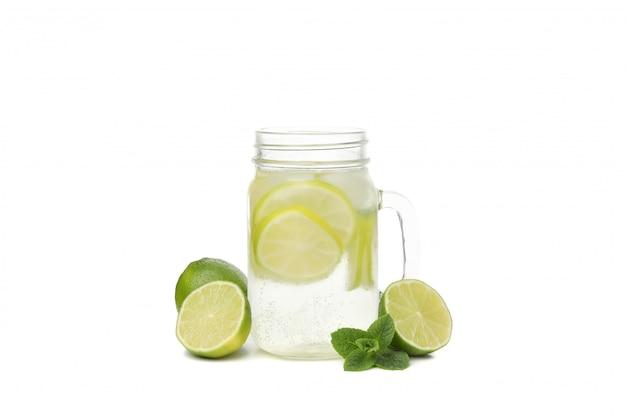 Glass jar of lemonade isolated on white surface