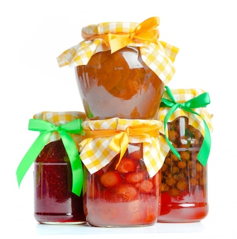 Glass jar with  jam isolated on the white background