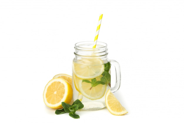 Glass jar with lemonade and lemons isolated on white surface