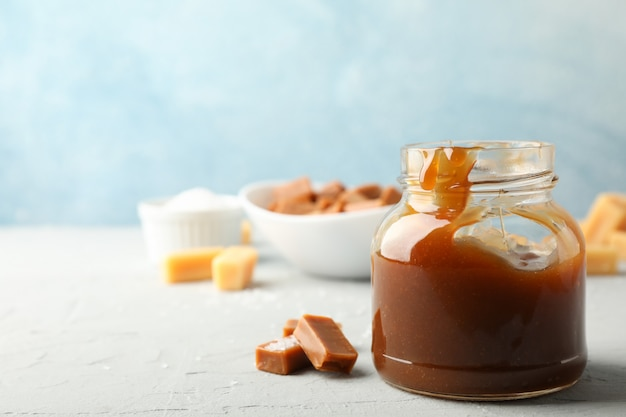 Glass jar with salted caramel and candies space for text