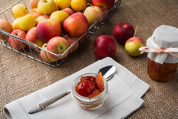 Glass jars of apple marmalade