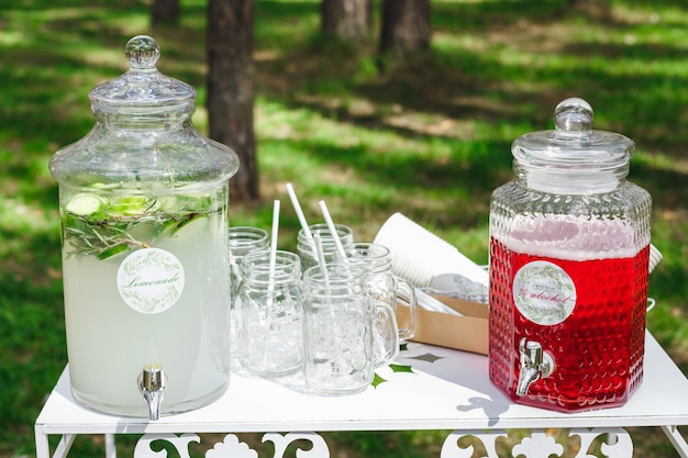 Glass jars of fresh lemonade on wedding candy bar