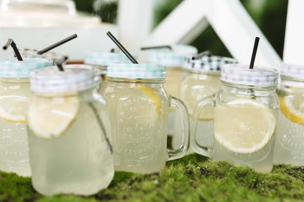 Glass jars of lemonade on candy bar