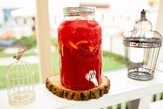 Glass jars of lemonade on catering food on table
