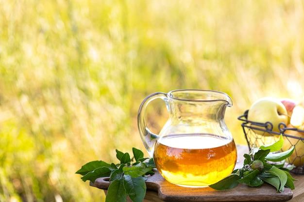 Glass jug with apple cider vinegar. copy space