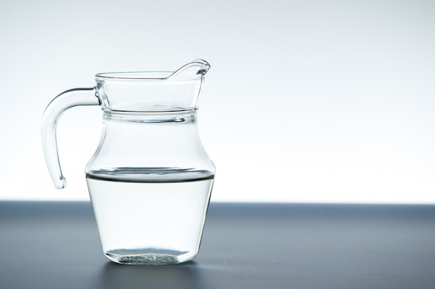 Glass jug with mineral water close up.