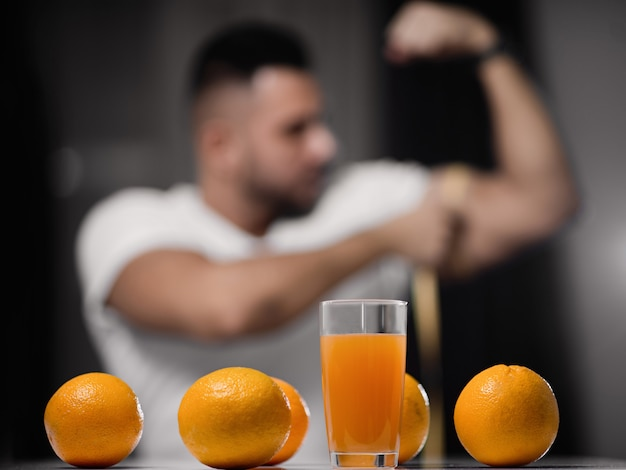 Glass of juice and oranges close-up
