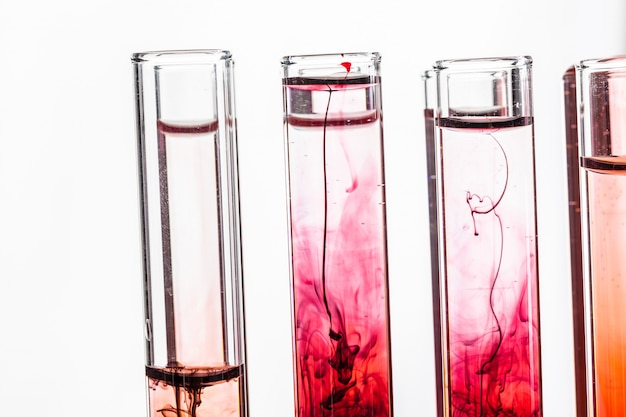 Glass laboratory chemical test tubes with liquid for analysis close up