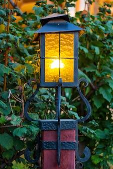 Glass lantern in retro style on a pole