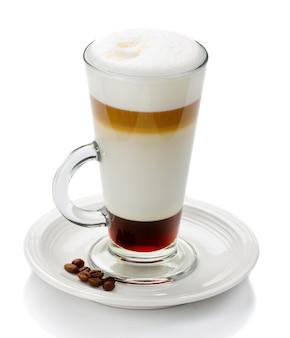 Glass of latte macchiato isolated