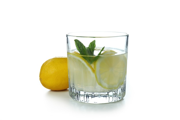 Glass of lemonade isolated on white surface
