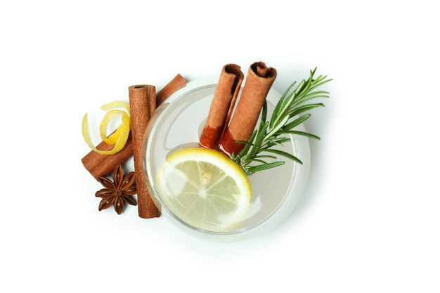 Glass of lemonade with cinnamon and rosemary isolated on white