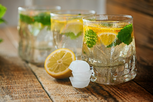 Glass of lemonade with fresh lemon and mint