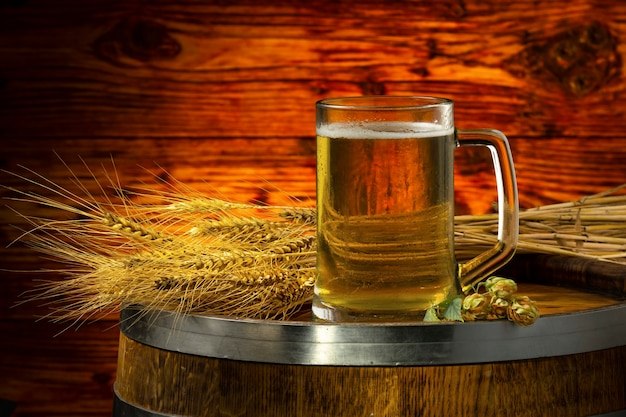 A glass of light beer and a sheaf of barley