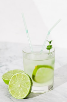 Glass of lime drink on table