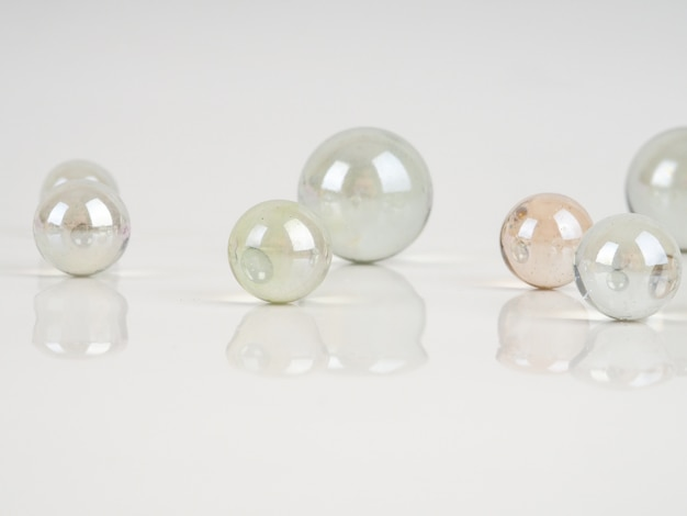 Glass marbles on a white surface