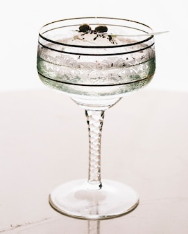 A glass of martini in white background.