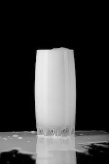 Glass of milk on black