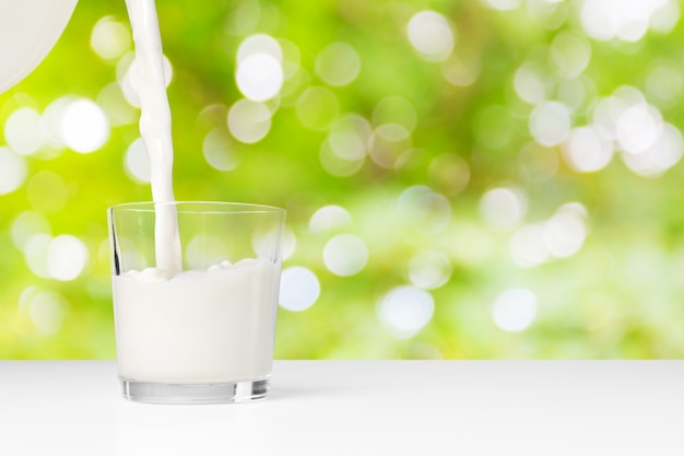 A glass of milk on a natural outdoor