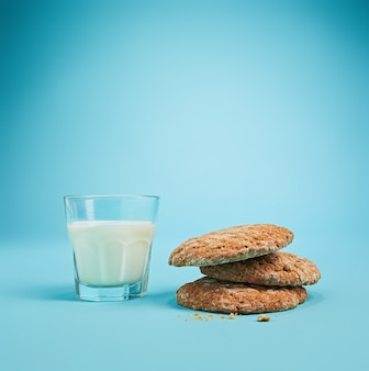 Glass of milk and oatmeal cookies