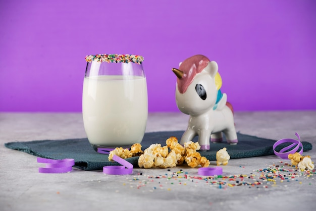 Glass of milk on the table with unicorn