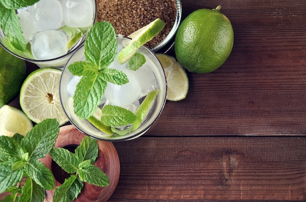 Glass of mojito cocktail with mint, lime and sugar