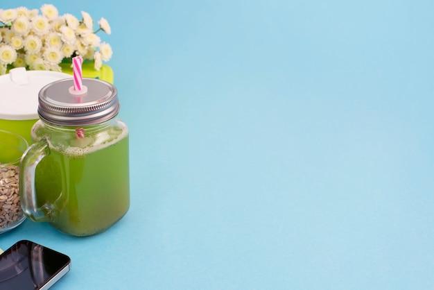 Glass mug with a tube with fresh smoothies.