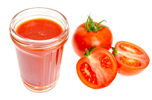 Glass of natural tomato juice fresh red tomatoes