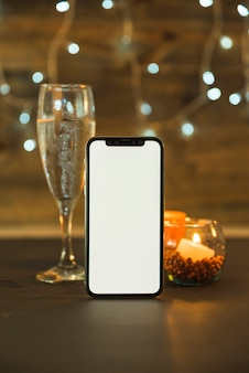 Glass of champagne with phone on table