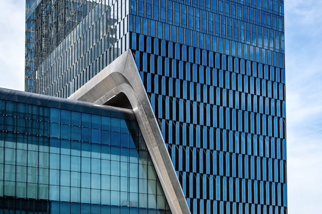 Glass office building facade with windows, architecture