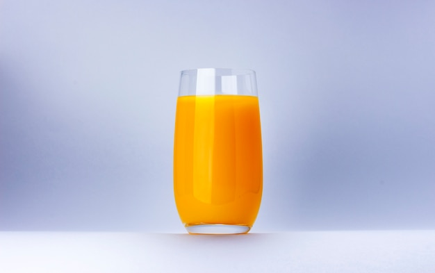 Glass of orange juice isolated on white background with copy space