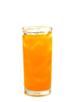 Glass of orange soda with ice on white background