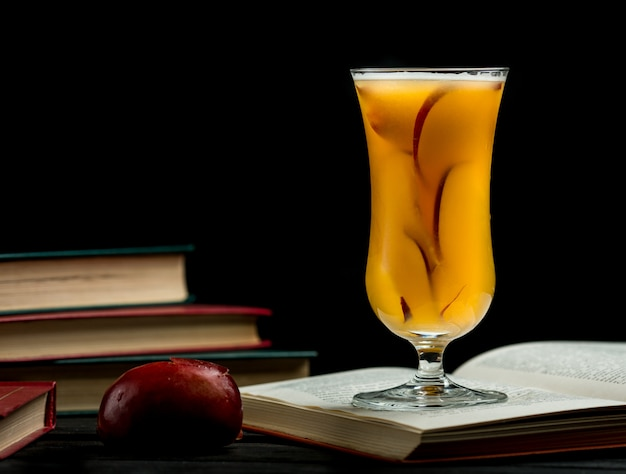 Glass of peach juice with slices