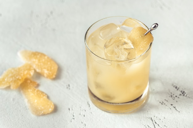 Glass of penicillin cocktail on white table