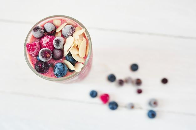 Glass of pink fruit smoothies milkshake or cocktail