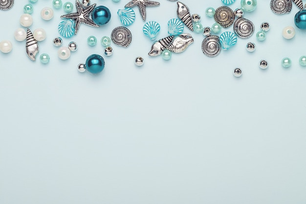Glass, plastic, metal beads. beads in the form of shells.