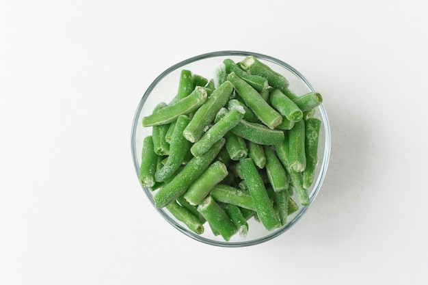 Glass plate with frozen green bean slices