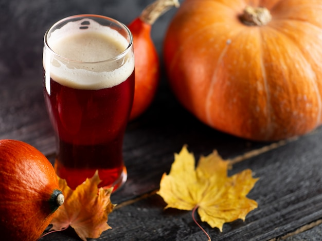 A glass of pumpkin ale on a wooden table