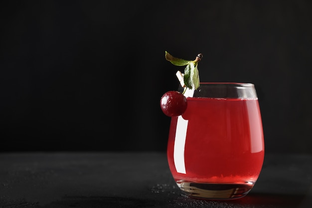 Glass of red cherry beverage or summer compote