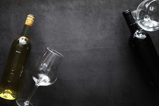 A glass of red dry wine on the table. dark bottle and glass of wine.