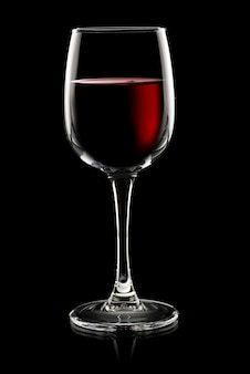 Glass of red wine on a black background
