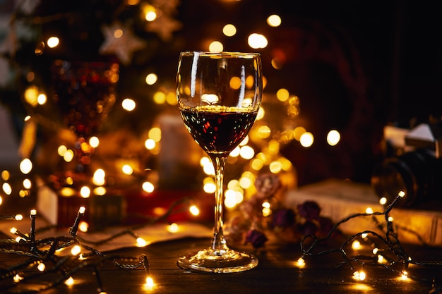 Glass of red wine. bokeh background. christmas, new year's or saint valentine holiday.