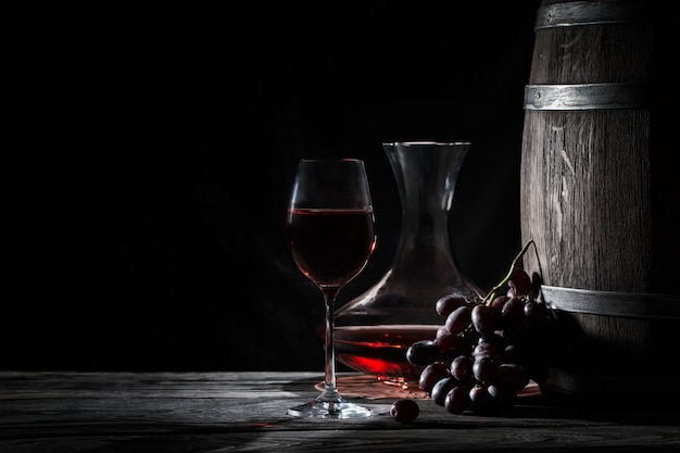 Glass of red wine, decanter and a barre