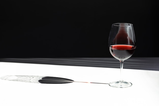 Glass of red wine with shadow copy space