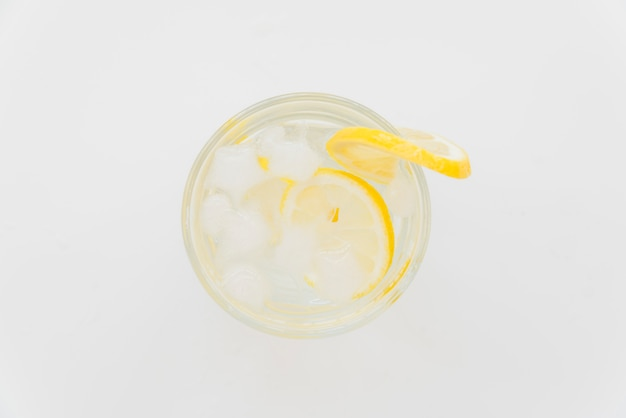 Glass of refreshing cold drink with lemon