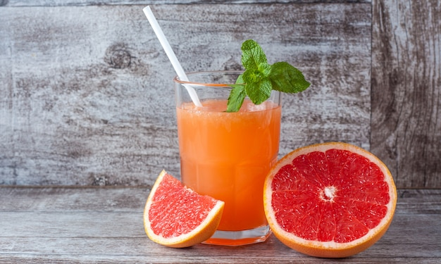 A glass of ripe grapefruit with juice