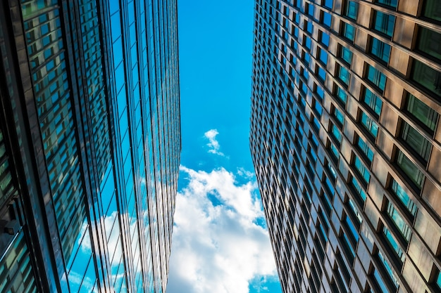 Glass roofs of business centers are photographed against the blue sky