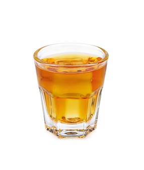 Glass of scotch whiskey and ice on  white background
