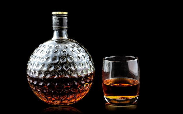 Glass of scotch whiskey premium and old decanter